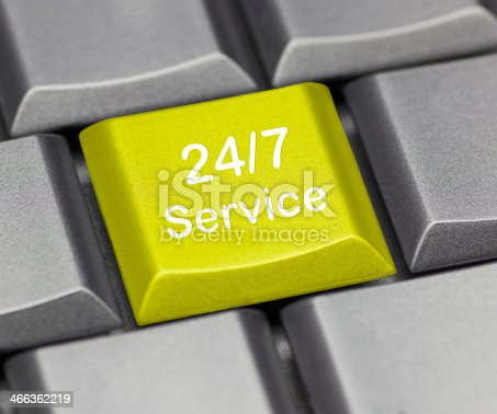 istock Computer key yellow - 24/7 service 466362219