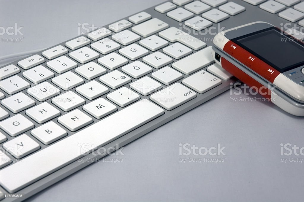 Computer keyboard and mobile phone stock photo
