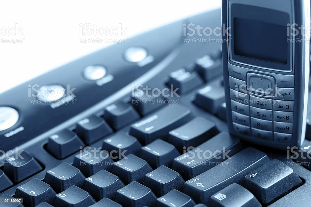 Computer keyboard and mobile phone royalty-free stock photo