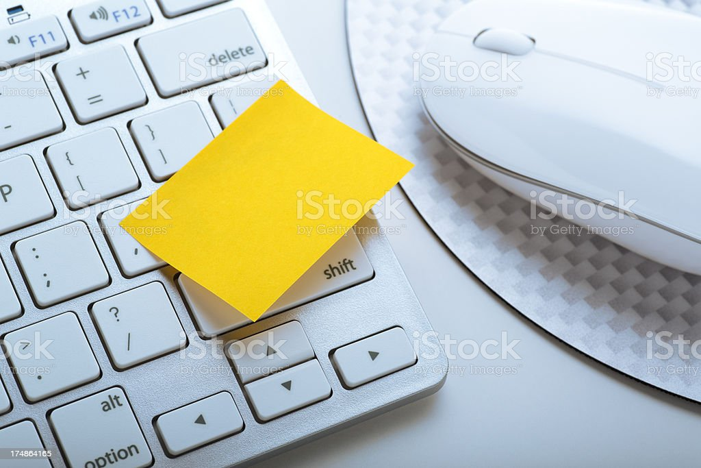 This is a close up photo of a computer keyboard and mouse with a...