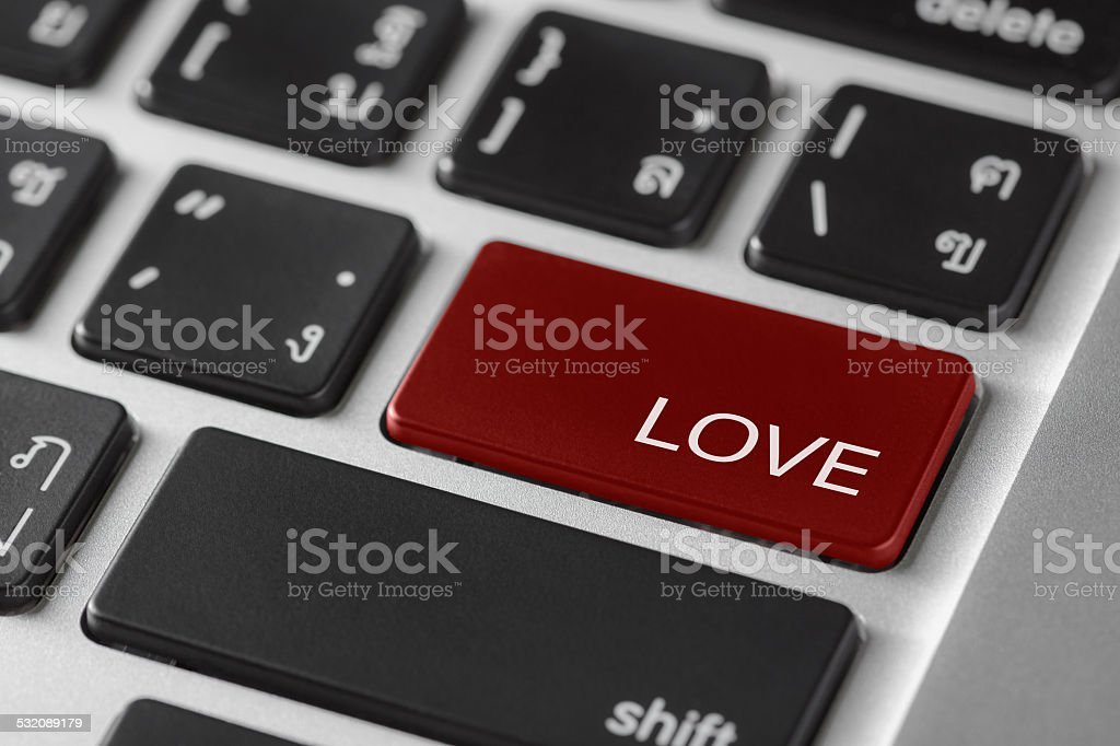 computer keyboard red enter button with word Love stock photo