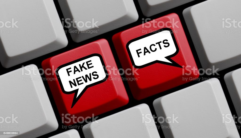 Computer Keyboard with balloons Fake or News Facts stock photo