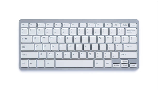 Computer keyboard with clipping path Modern aluminum computer keyboard isolated on white background with clipping path computer keyboard stock pictures, royalty-free photos & images