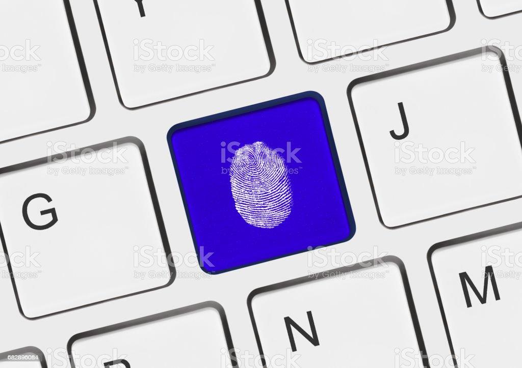 Computer keyboard with fingerprint stock photo