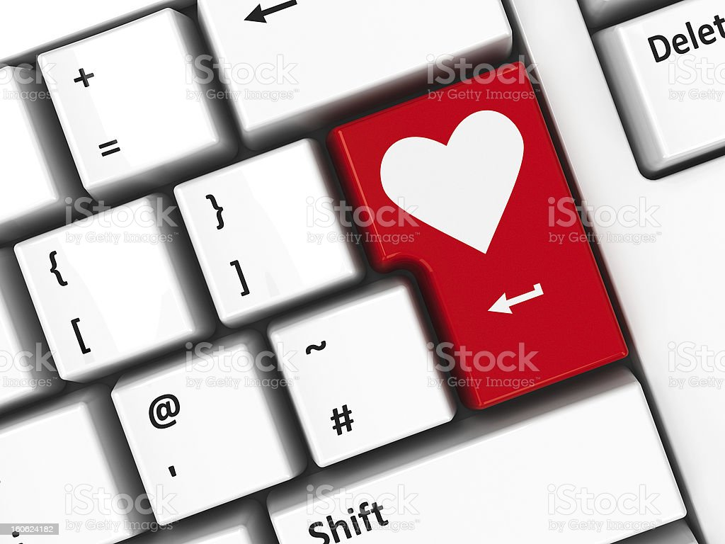 Computer keyboard with heart on enter button stock photo