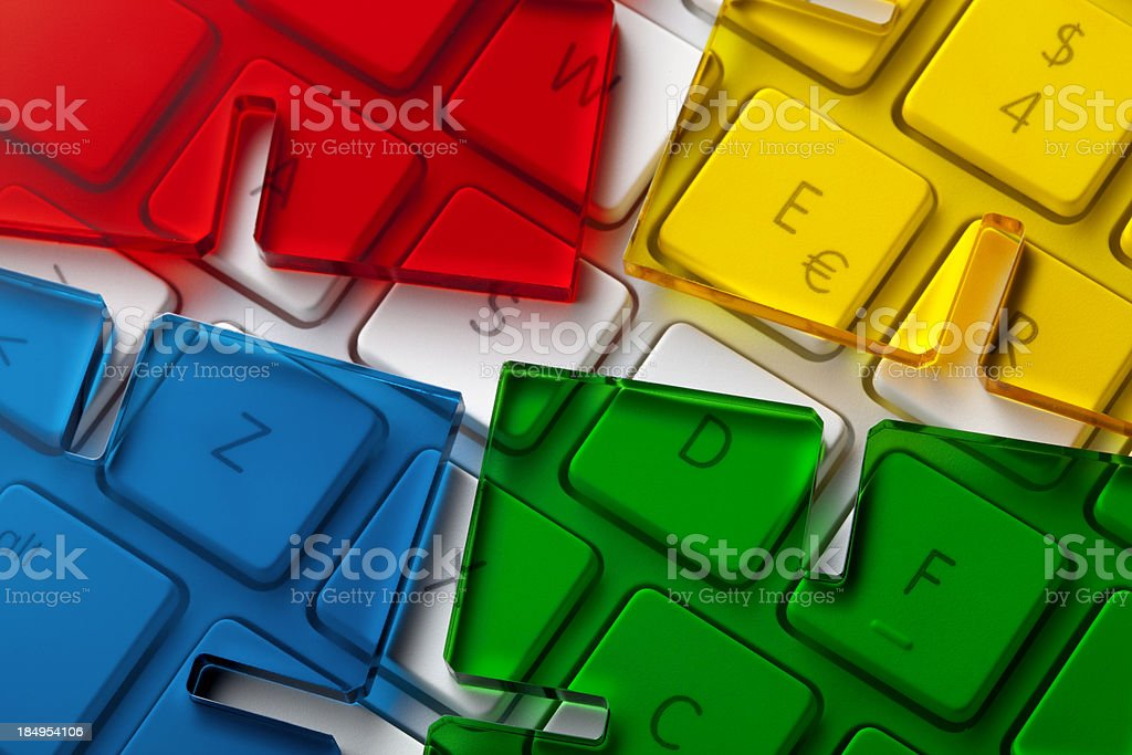 Computer keyboard with pieces of a puzzle royalty-free stock photo