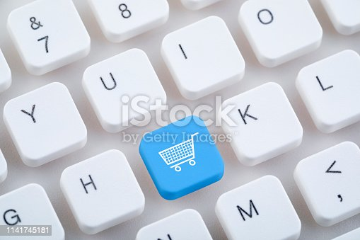 istock Computer keyboard with shopping cart button. Online shopping concept. 1141745181