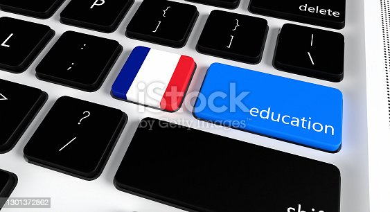 Computer keyboard with word Education and French Flag, selected focus on enter button.