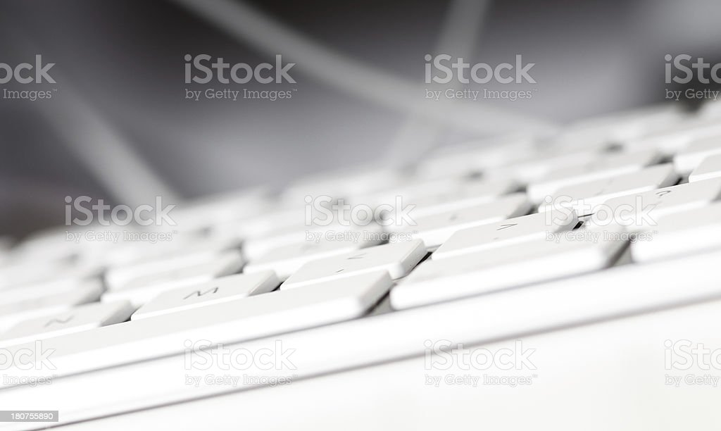 Computer keyboardand cables on dark background royalty-free stock photo