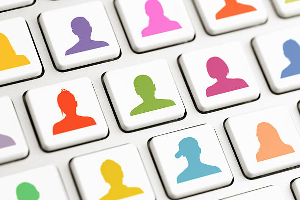 Computer keys with colored avatars stock photo
