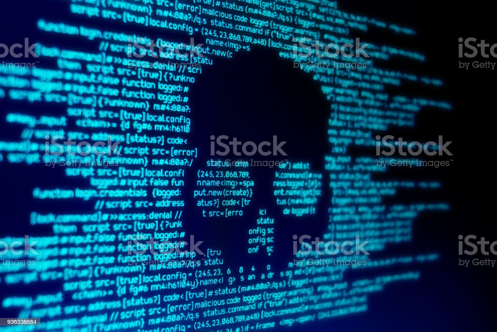 Computer Malware Attack Computer code on a screen with a skull representing a computer virus / malware attack. Antivirus Software Stock Photo