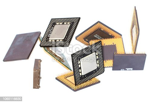 Close view detail of some computer microprocessors isolated on  a white background.