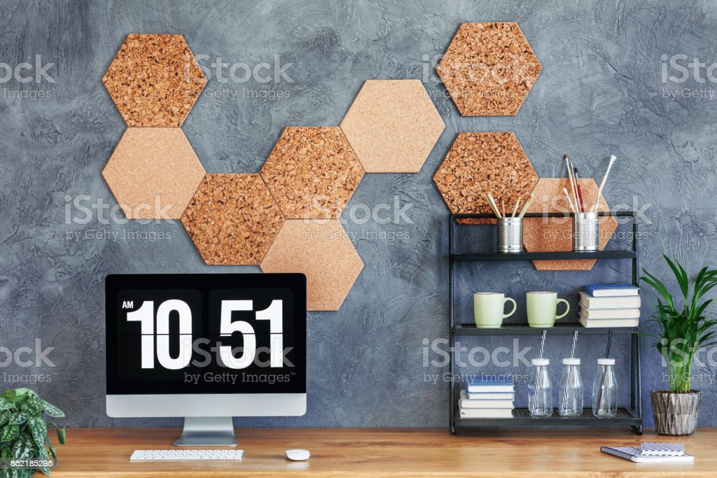 Computer monitor on wooden desk stock photo