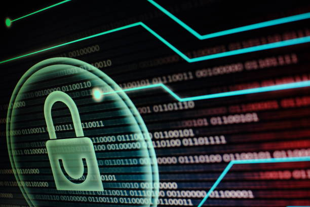 computer monitor screen displaying padlock symbol in a circular light bubble. binary code data bits background. red and blue colour. cyber security concept. stock photo