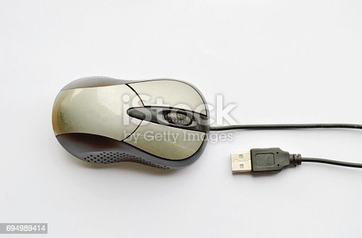 688535966 istock photo computer mouse and cable plug in on white background 694989414