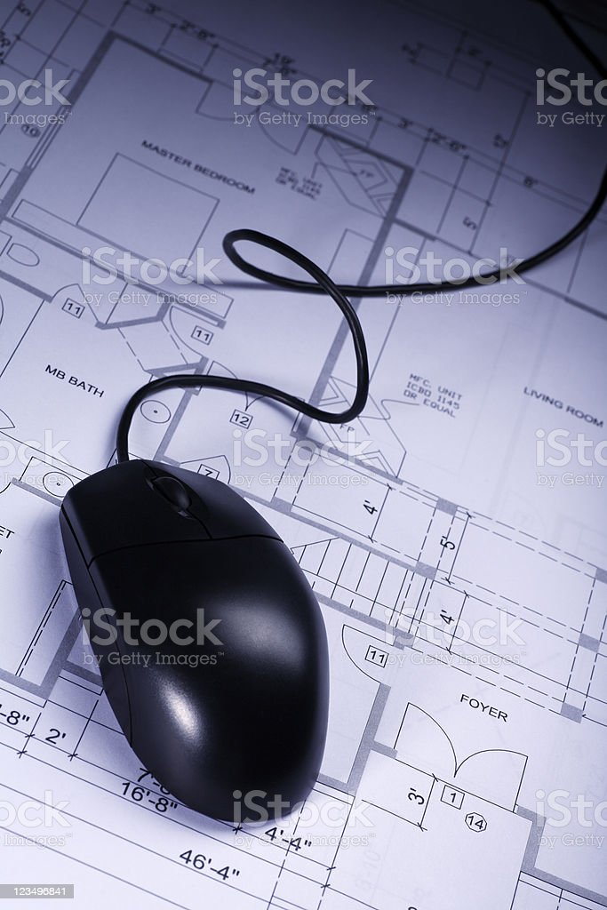 computer mouse on blueprints royalty-free stock photo