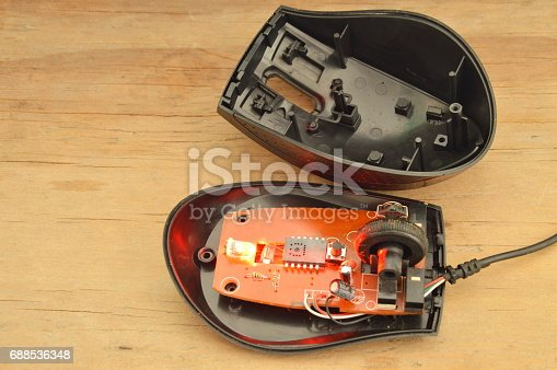 istock computer mouse separated parts on wooden board 688536348