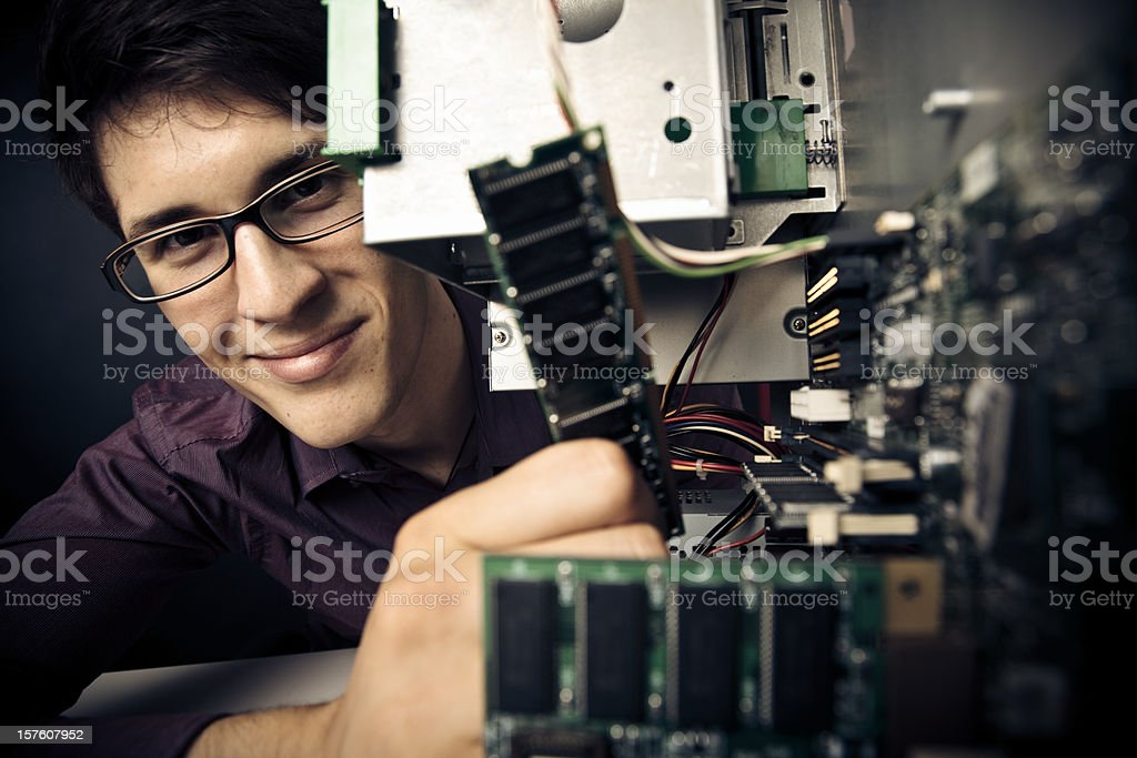 computer nerd upgrading his hardware stock photo