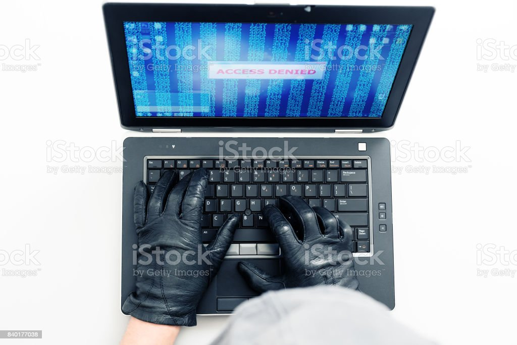 Top View of Computer Network Expert trying to hack the terminal using...