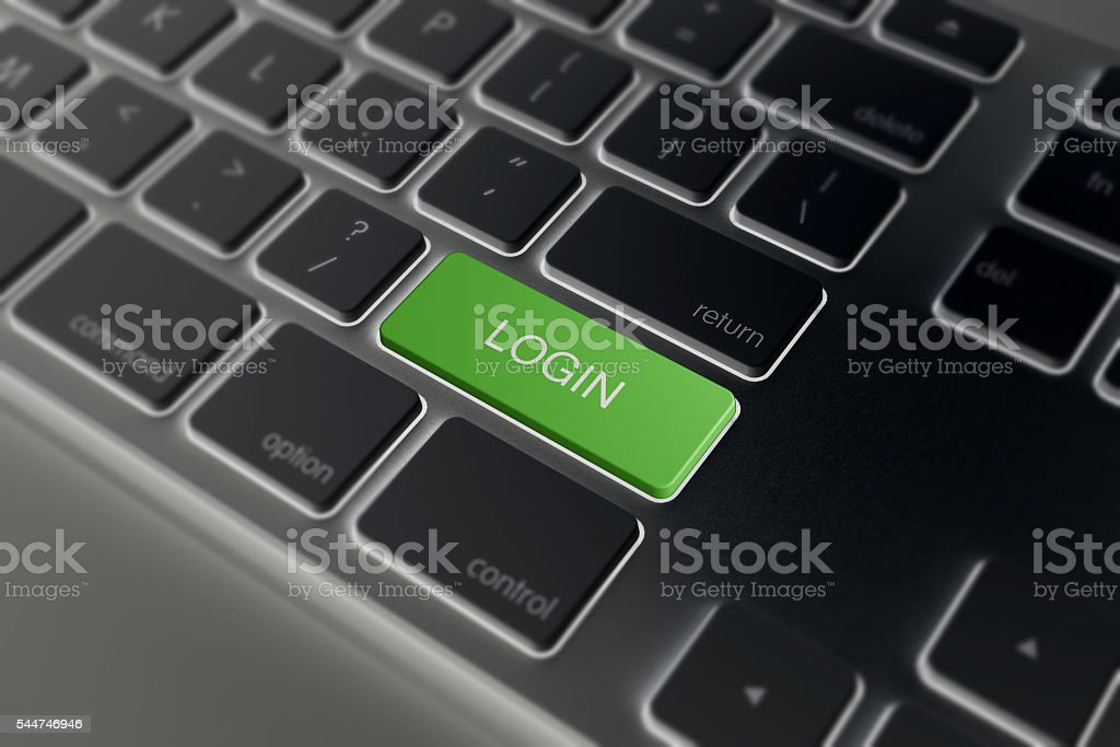 Computer notebook keyboard with green Login key stock photo