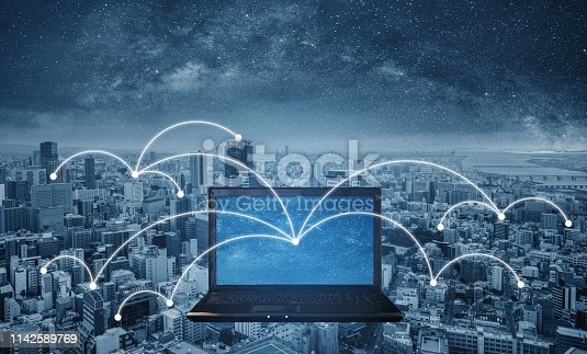 istock Computer notebook with network connection in the city. Internet networking and connection 1142589769