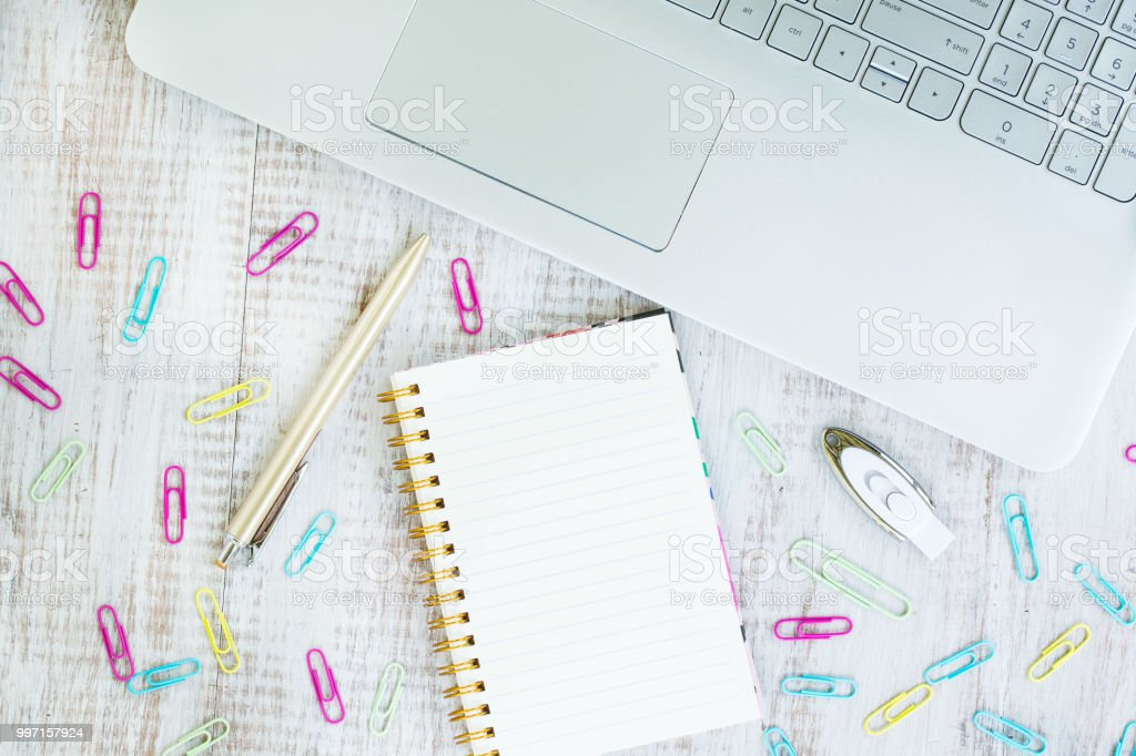 Computer Office Desk With Laptop Notebook and Pen stock photo