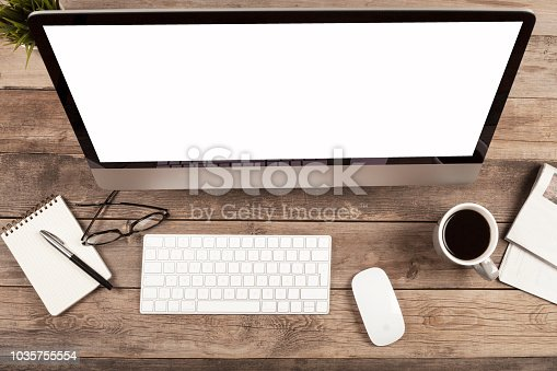 862672018 istock photo computer over wooden office desk 1035755554