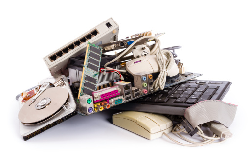 heap of electronic and computer hardware waste for disposal or recycling - junked computer parts
