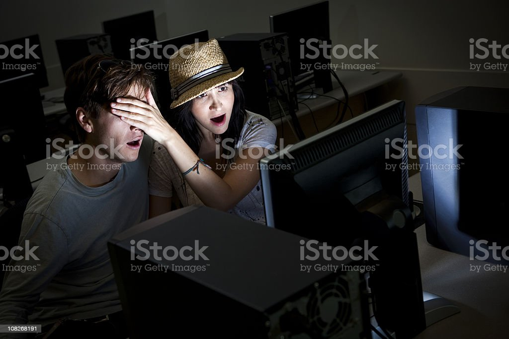 Computer Pornography with Boy and Girl stock photo