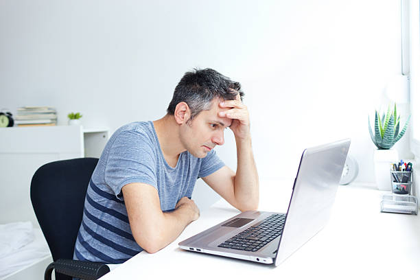 Computer problem Man having trouble with laptop computer bug stock pictures, royalty-free photos & images
