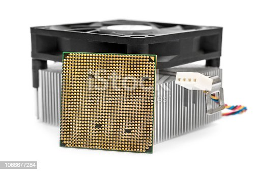 istock Computer processor and cooler with radiator on white. 1066677284