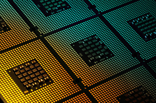 computer processors aligned with lighting effects postproduction, background. stock photo