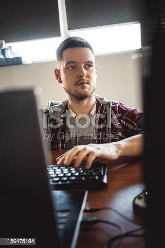 872006502 istock photo computer programmer. office worker. 1156475194