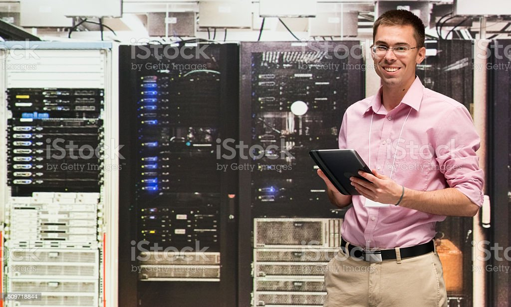 Computer programmer using digital tablet stock photo