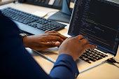 istock Computer programmer working on laptop 1265176772