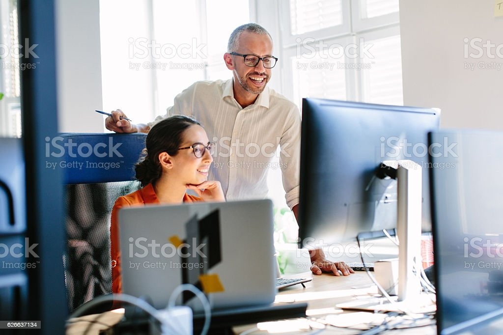 Computer programmers working together stock photo