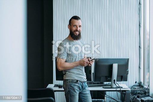 istock computer programming software developer office 1159700417
