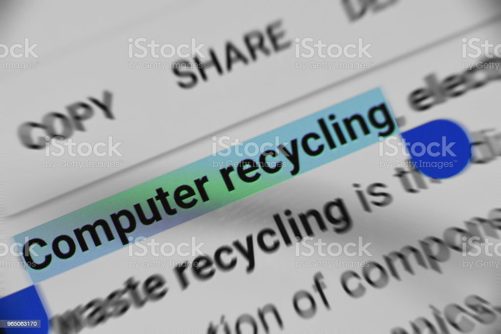Computer recycling information on mobile screen zbiór zdjęć royalty-free