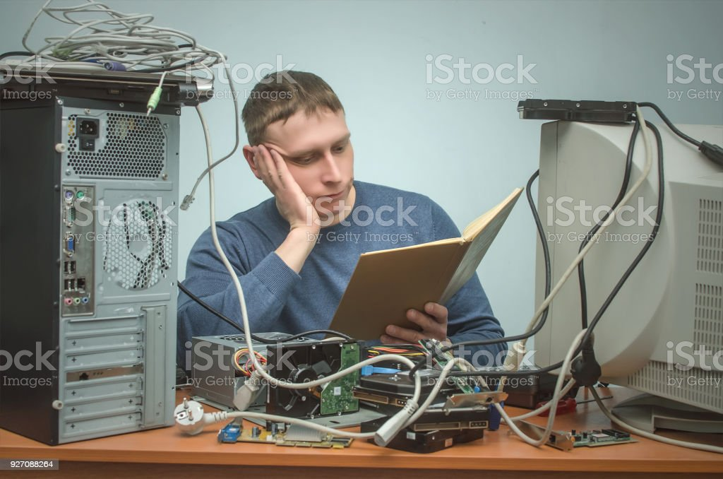 Computer repairman. IT Support. Computer technician engineer man. Support service concept. System administrator. stock photo