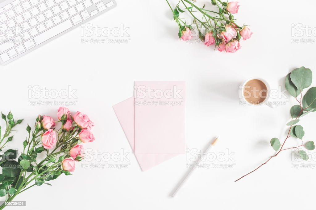 Computer, rose flowers, eucalyptus branch. Flat lay, top view