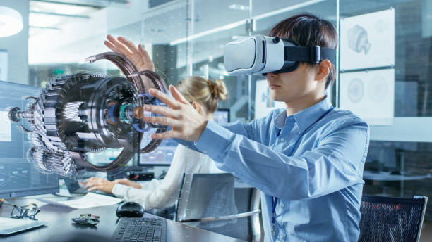computer science engineer wearing virtual reality headset works with 3d model hologram visualization, makes gestures. in the background engineering bureau with busy coworkers. - augmented reality stock photos and pictures
