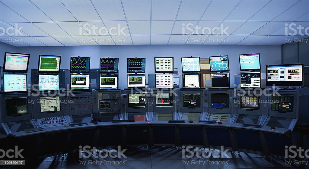 Computer screens in control room stock photo