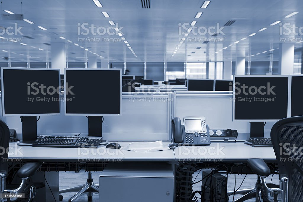 Computer Screens in Large Modern Office Interior, Toned Image royalty-free stock photo