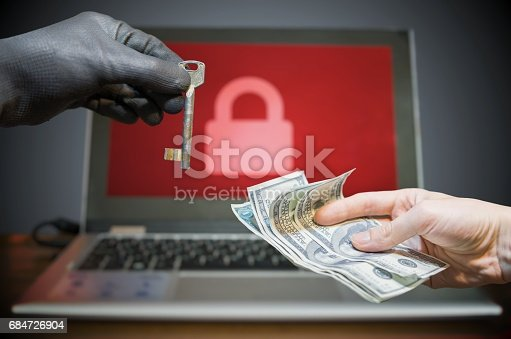 istock Computer security and hacking concept. Ransomware virus has encrypted data in laptop. Hacker is offering key to unlock encrypted data for money. 684726904