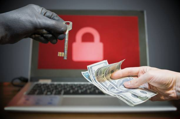 Computer security and hacking concept. Ransomware virus has encrypted data in laptop. Hacker is offering key to unlock encrypted data for money. stock photo