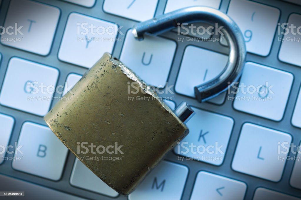 computer security concept with broken lock stock photo