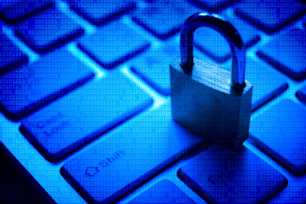 Computer security A security lock on computer keyboard with blue digital background Stolen Intellectual Property stock pictures, royalty-free photos & images