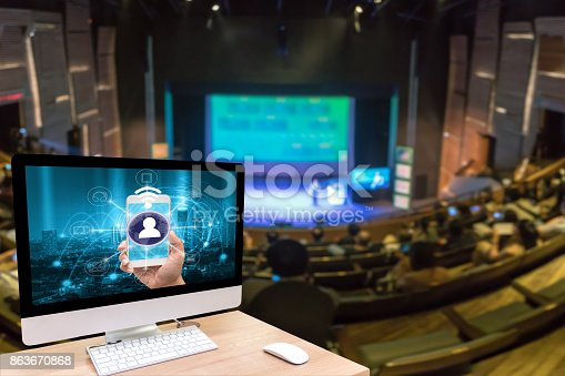 istock Computer set showing the mobile payments and online shopping with moni channel screen over the Abstract blurred photo of seminar room with attende background, business and education concept 863670868