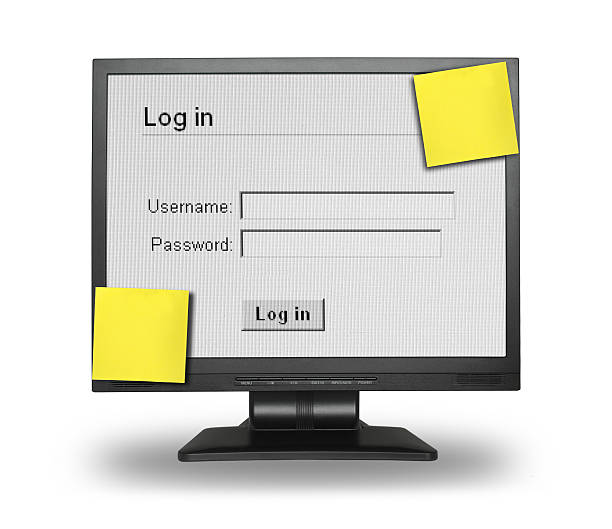 Computer Showing Log In Screen With Yellow Stick Notes Stock