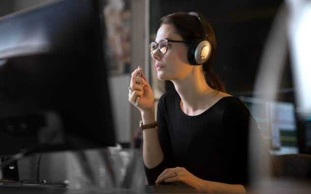 Computer sound editor woman stock photo